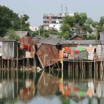 Slum houses in Dhaka, Bangladesh, raised above ground level to protect against flooding. IRIN/Manoocher Deghati.
